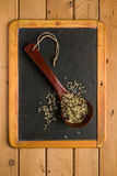 Mix of rice in a wooden spoon on a chalkboard Stock Photo