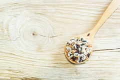 Mix rice on wooden spoon with wooden background. Product of Thai Stock Images
