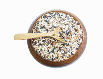 Mix  rice on wooden spoon in a wooden bowl isolated on white  ba Stock Images