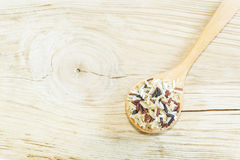 Mix  rice on wooden spoon on wooden white  background. Royalty Free Stock Image