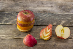 Mix of ripe apple and orange on a wooden desk Royalty Free Stock Photography