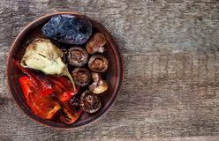 Mix roasted vegetables on a plate top view Stock Photos