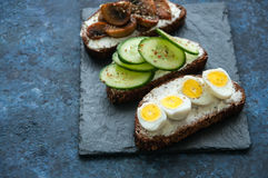 Mix of rye bread bruschettas with various filling Stock Photos