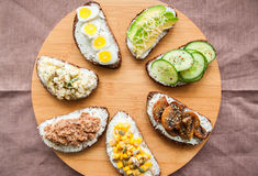 Mix of rye bread bruschettas with various filling. Stock Image