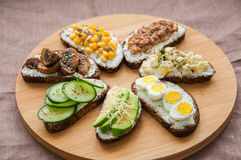 Mix of rye bread bruschettas with various filling. Royalty Free Stock Photo