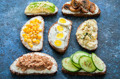 Mix of rye bread bruschettas with various filling. Royalty Free Stock Photography