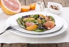 Mix salad with citrus stock photography