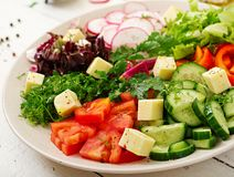 Mix salad from fresh vegetables and greens herbs. Dietary menu. Proper nutrition. Healthy lifestyle Stock Images