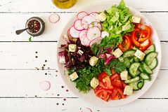 Mix salad from fresh vegetables and greens herbs. Dietary menu. Proper nutrition. Healthy lifestyle. Flat lay. Top view Royalty Free Stock Images