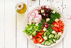 Mix salad from fresh vegetables and greens herbs. Dietary menu. Proper nutrition. Healthy lifestyle. Flat lay. Top view Stock Photo