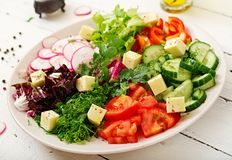 Mix salad from fresh vegetables and greens herbs. Dietary menu. Proper nutrition. Healthy lifestyle Royalty Free Stock Photo