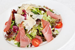 Mix salad with parma ham Royalty Free Stock Image