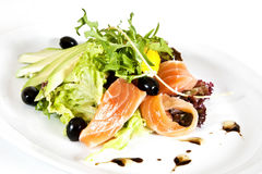 Mix salad. With salmon, avocado and arugula stock photo