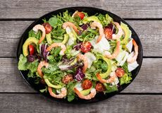 Mix of salad with shrimps avocado and cherry tomatoes . Healthy food background. Mix of salad with shrimps , avocado and cherry tomatoes . Healthy food royalty free stock photo