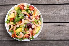 Mix of salad with shrimps avocado and cherry tomatoes . Healthy food background. Mix of salad with shrimps , avocado and cherry tomatoes . Healthy food stock image