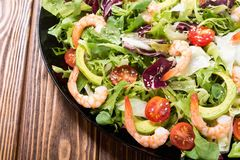 Mix of salad with shrimps avocado and cherry tomatoes . Healthy food background. Mix of salad with shrimps , avocado and cherry tomatoes . Healthy food royalty free stock images