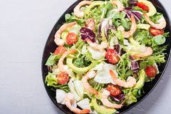 Mix of salad with shrimps avocado and cherry tomatoes . Healthy food background. Mix of salad with shrimps , avocado and cherry tomatoes . Healthy food stock images