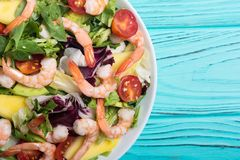Mix of salad with shrimps avocado and cherry tomatoes . Healthy food background. Mix of salad with shrimps , avocado and cherry tomatoes . Healthy food royalty free stock image