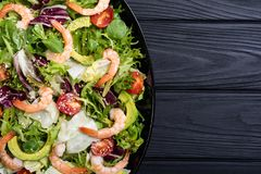 Mix of salad with shrimps avocado and cherry tomatoes . Healthy food background. Mix of salad with shrimps , avocado and cherry tomatoes . Healthy food royalty free stock photos