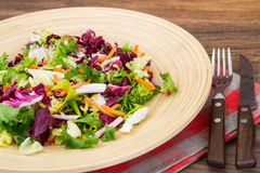 Mix salads with pomegranate and ham Stock Photos