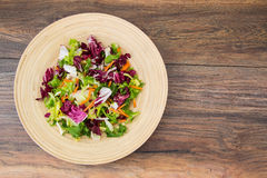 Mix salads with pomegranate and ham Royalty Free Stock Photos