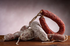 Mix of salami. Mix of italian salami on wood table stock images