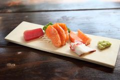 Mix sashimi. On wooden plate stock photography