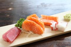 Mix sashimi. On wooden plate royalty free stock images