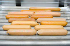 Mix sausages on hot dog broiler Stock Images