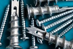 Mix of screws and drywall Royalty Free Stock Images