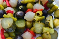 Mix of seasoned vegetables. Hot peppers, onions, olives, healthy, food, vegetables, spicy, diet Stock Photo