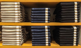 Mix Size of Pile Classic Light Gray, Blue and Black Jeans Texture with Paper Tag Exhibit on Wooden Shelf Royalty Free Stock Image