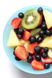 Mix slice fresh fruit in bowl. Mix slice fruit are kiwi, strawberry, pineapple, blueberry ,close up on top Stock Images