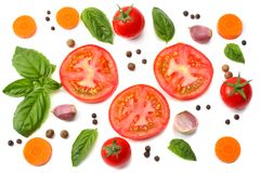 Mix of slice of tomato, basil leaf, garlic and spices isolated on white background. top view stock image