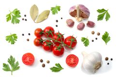 Mix of slice of tomato, basil leaf, garlic and spices isolated on white background. top view stock images
