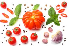 Mix of slice of tomato, basil leaf, garlic and spices isolated on white background. top view stock photos