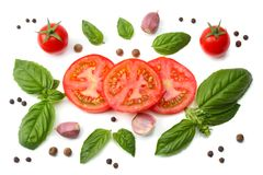 Mix of slice of tomato, basil leaf, garlic and spices isolated on white background. top view stock photography