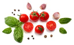 mix of slice of tomato, basil leaf, garlic and spices isolated on white background. top view stock photo