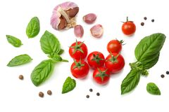 Mix of slice of tomato, basil leaf, garlic and spices isolated on white background. top view royalty free stock image
