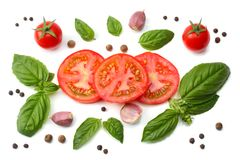 Mix of slice of tomato, basil leaf, garlic and spices on white background. top view stock image