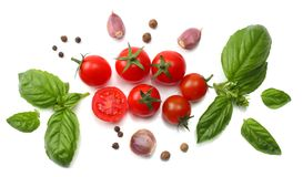 Mix of slice of tomato, basil leaf, garlic and spices on white background. top view stock photo