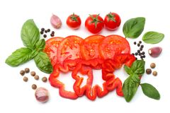 Mix of slice of tomato, basil leaf, garlic, sweet bell pepper and spices isolated on white background. top view royalty free stock photos