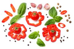 Mix of slice of tomato, basil leaf, garlic, sweet bell pepper and spices isolated on white background. top view stock photo
