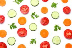 mix of sliced cucumber with sliced carrot and tomato isolated on a white background top view stock photos