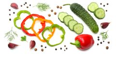 Mix of sliced cucumber, garlic, sweet bell pepper and parsley isolated on white background. top view Stock Image