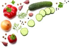 Mix of sliced cucumber, garlic, sweet bell pepper and parsley isolated on white background. top view stock photos