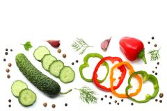mix of sliced cucumber, garlic, sweet bell pepper and parsley isolated on white background. top view royalty free stock photo