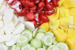 Mix Sliced Fruit. Pieces of cucumber, yam, guava, and mango Stock Images