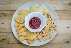 Mix snacks in dish with ketchup Royalty Free Stock Photography