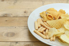 Mix snacks in dish on wood background Stock Image